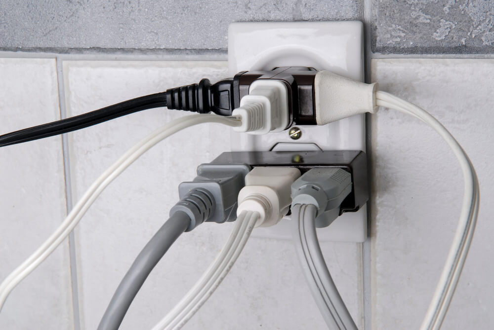 What causes an overloaded power outlet